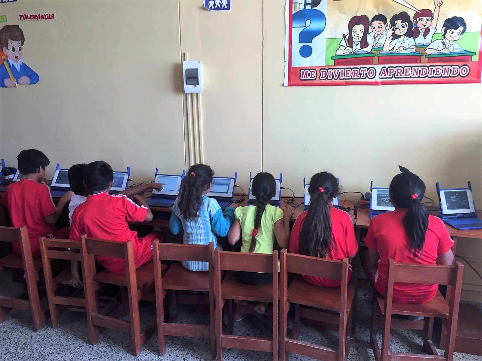 kids at school in Latin America  with internet access and computers having fun learning